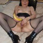 Getting her hand on the banana to insert it!
