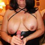 Handjob Photo B:  Oops, I made him cum and now I'm all messy and covered in cum!