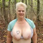 Wife happily exposing her big tits on a nature walk again.