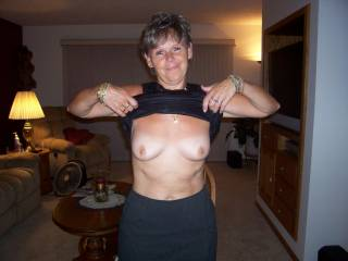 This is my wife baring her tits. She loves to get her tits out for any man she likes because it makes them want to fuck her and she loves to get fucked. What would you do to her tits and nipples if she pulled up her top for you like this?