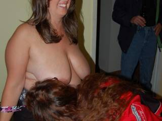hotwife getting some girl on girl while others watch at party