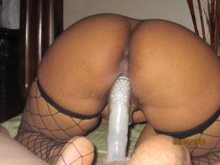 You have a fine curvaceous ass! Lets see this same shot minus the toy. I would love to see your honey pot