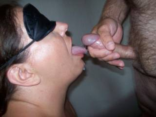 Found some more pics from a 3some back in the summer, Here she is getting fed some cum by the other guy as she is blindfolded.
