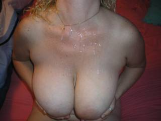 frontal view of the wifes huge cum splattered tits