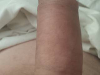 foreskin pulled back a little.   i LOVE how this feels