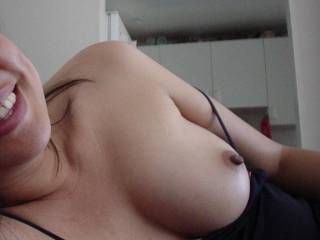 I definitely like you!!! What a pretty smile and a very nice boob and hard nipple!!!! Could I see the other one?