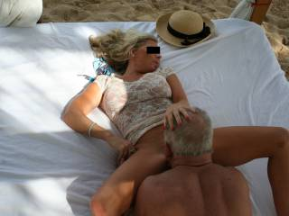On a beach bed at a swingers resort - taken by a couple we met. And yes, she fucked the other guy too! She\'s a wonderful mixture of sweetheart, professional woman and total slut. Any smart, funny, very well hung guys in Central Virginia want to fuck her?