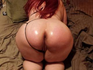Ugh!! After spanking Vixxxen ass to a bright red to match her sexy hair,I had to totally oil it up and get in those holes! Imagine stepping up and shooting your load into one of \'em? -Dddy
