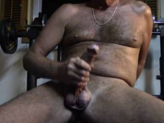A good stroke of my cock eventually laying back on my work out bench , lifting my legs and letting you see all of me before I cum in your face. Still rehabbing from surgery so still out of shape but the cock is still long and hard. Yes?