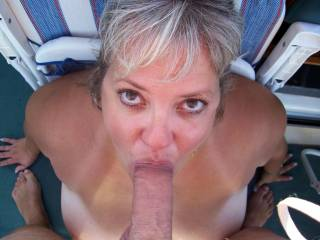 I'd love to look down and see those big brown eyes looking at me while she sucks my cock.