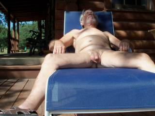 Enjoying the sun on my limp cock, need someone to get me hard