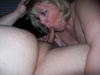 Mrs Daytonohfun sucking away on my cock as her hubby takes pics!  I love holding her head as she blows me!