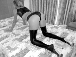 hold on to your heels as I spank your ass I know you will like it when ive finished with you. bite on the pillow as I strike you ass and catch your pussy making it throb and sting with pleasure