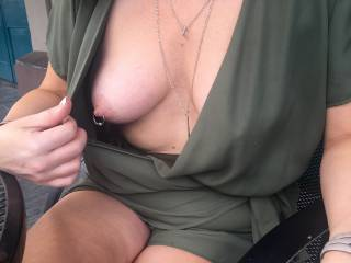 Showing my hot pierced nipples to my man on our lunch date!