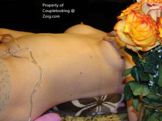 Again playing on kitchen counter next to the Roses from our celebration. A beautiful side view with strategically placed roses. Ladies and Guys of Zoig, what do you think of this lovely body. Please share your dirty thoughts.