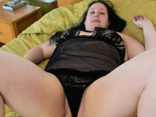 Lying back to give me a better view of her lingerie - and what\'s underneath it...
