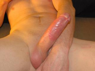 I was giving him a deep, sloppy blow job but took a break so I could take some photos of his porn star cock....you can even see my lipstick marks on his shaft