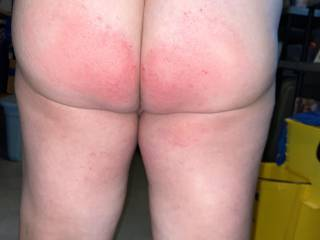 A wench's red ass after being paddled for being good by her Captain