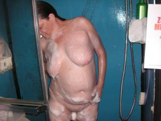 tommie takeing a shower after shaveing and getting ready and all soaped up to go to work ...