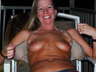 showing my tits on the hotel balcony.PLEASE CUM ON THEM and send it to me or post it