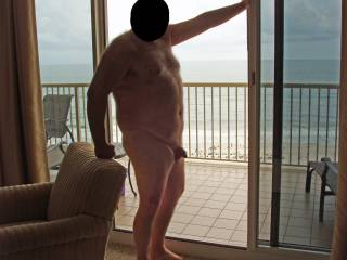 Hubby posing in the nude at our condo while on our summer 2008 beach vacation.