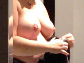 Friend taking of her bra and showing her nice big tits. Don' you yust love them?