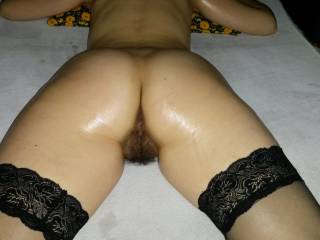 Black hairy pussy and sexy black stockings lubricated from behind ... waiting for you to make the fuck?