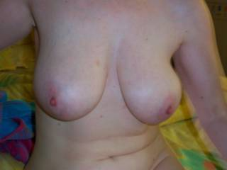 Would you like to squeeze them around my cock and wank it until it covers them in hot creamy cum?