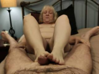What a great way to enjoy sex. This married woman uses her beautiful feet for pleasure, stroking that cock, kneading those balls, making it cum all over her toes. There may not be anything sexier than a woman using her feet to make a man give her cream.