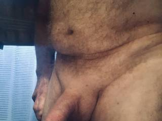 Shaved cock and balls, feeling lustful.