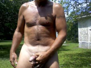 Nice cock outdoors while takes pics.