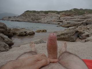 Horny on a little desert beach ; beside me a young german couple were naked, he was fingering his gf ; they let me watch, then get naked and jerk in front of her ; 5 mns later she came to my towel smiling, and sucked me off while he took pics..