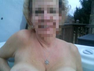 Topless in my hot tub