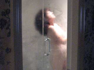 wife takes a steamy shower in hotel room