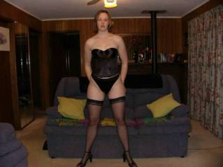 Slutty? nope, well dressed and up for it....yep....killer heels and stockings, love the top and panties too!