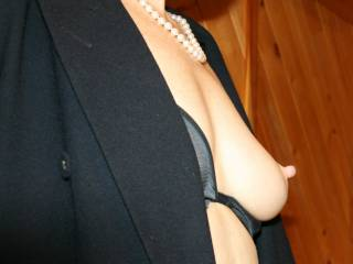 so classily elegant... lustrous pearl necklace....sharp top.... soft lingerie.... and so pert peaked... defined nipple..... i just want to take that nip into my lips for a soft tender, protracted suckle... and just..... give that tip little teeth bites..... sharp but tenderly soft.... transmit to you the thrill of being desired