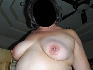 I\'m stroking cock off camera in this pic!  Would you play with my tits and suck on my nipples if I stroked your cock?