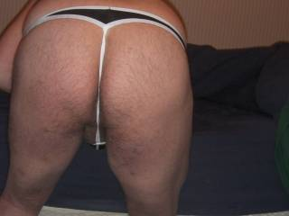 It looks perfect… hairy and very sexy.  I want to lick and spank it… if you would let me that is