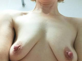 Thank You everyone for the comments and messages you left us on our other postings.  We both read them.  Several times you have mentioned how much you like my nipples.  Here is one I sent to hubby that really shows them.  Do you still like them?