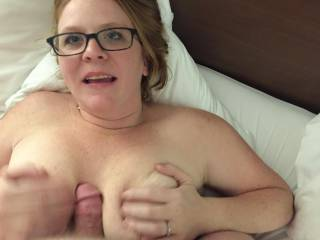 Getting fucked between my tits before he penetrates me.
