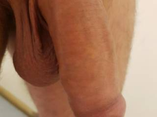 Flaccid but not small.  Uncut