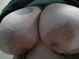 Dang. Those are some big ass tits. I love them though, and would love to suck and fuck them.