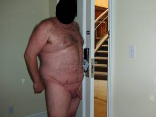 Weekend getaway at a luxury resort. Hubby patiently posing for some nude pics before I gave him a blowjob...and some pussy!  I was so hoping the maid would show up while he had the door open!