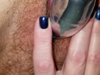 Wife taking it deep in her pussy as she rubs it....