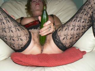 Damn she is so sexy !! Love that hairy pussy and those sexy stockings!!