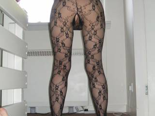 Wow! I'd really love to rip that catsuit off you as I rubbed my cock up and down your sexy legs.