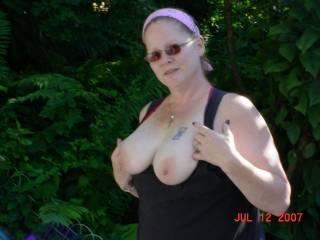 My wife flashing her tits in the backyard.