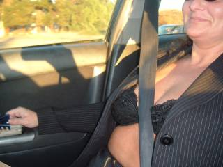 Wife in her suit without a shirt. This is how I spent my day at work, though I did keep my suit jacket buttoned. Still, wonder how many people saw my bra!