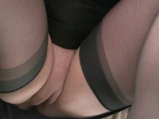 A continuing theme of Sally out in public showing some upskirts pics of her commando pussy.... I think that stockings make it look so pretty.