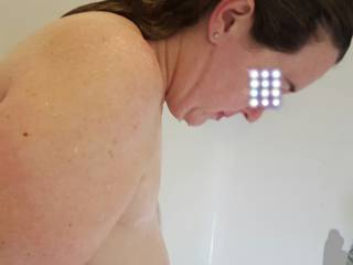 getting clean in the shower, heavy milk filled tits hanging free